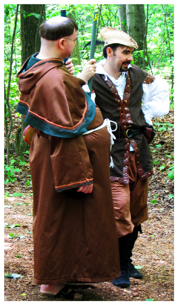 Friar Tuck and Robin Hood in the outlaw camp at the Robin in the Hood Festival.