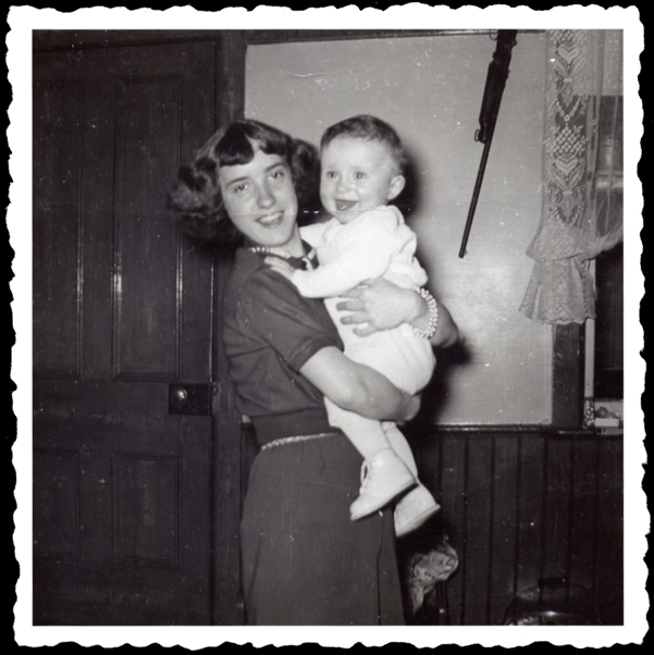 Aunty proudly displays her nephew in a 1950's worn out snapshot.