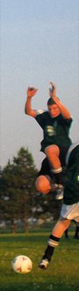 Cropped original blurred soccer action shot.
