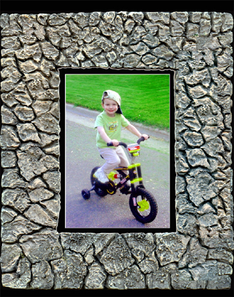 Digital Rock Frames a boy on his bike.