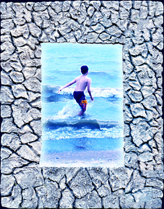 Digital Rock Frames a child running into the surf.