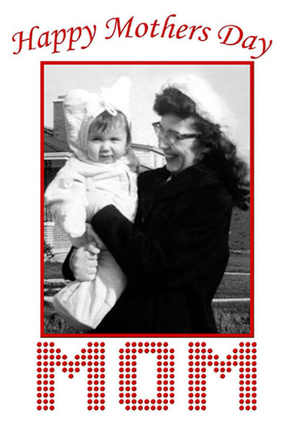 Black & White ′50′s photograph of mother holding baby wearing a bunny snowsuit