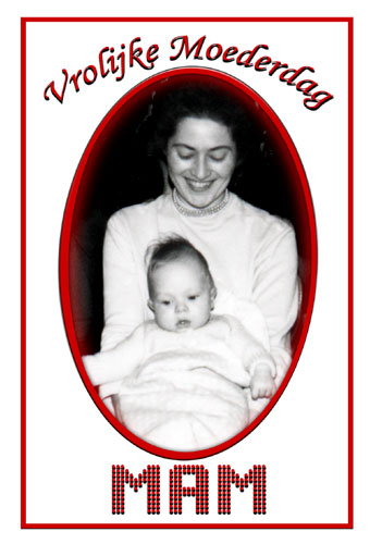 Black & White ′50′s photograph of proud mother holding baby