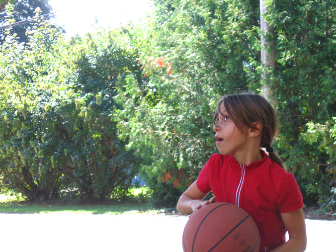 Girl poised to shoot a basketball